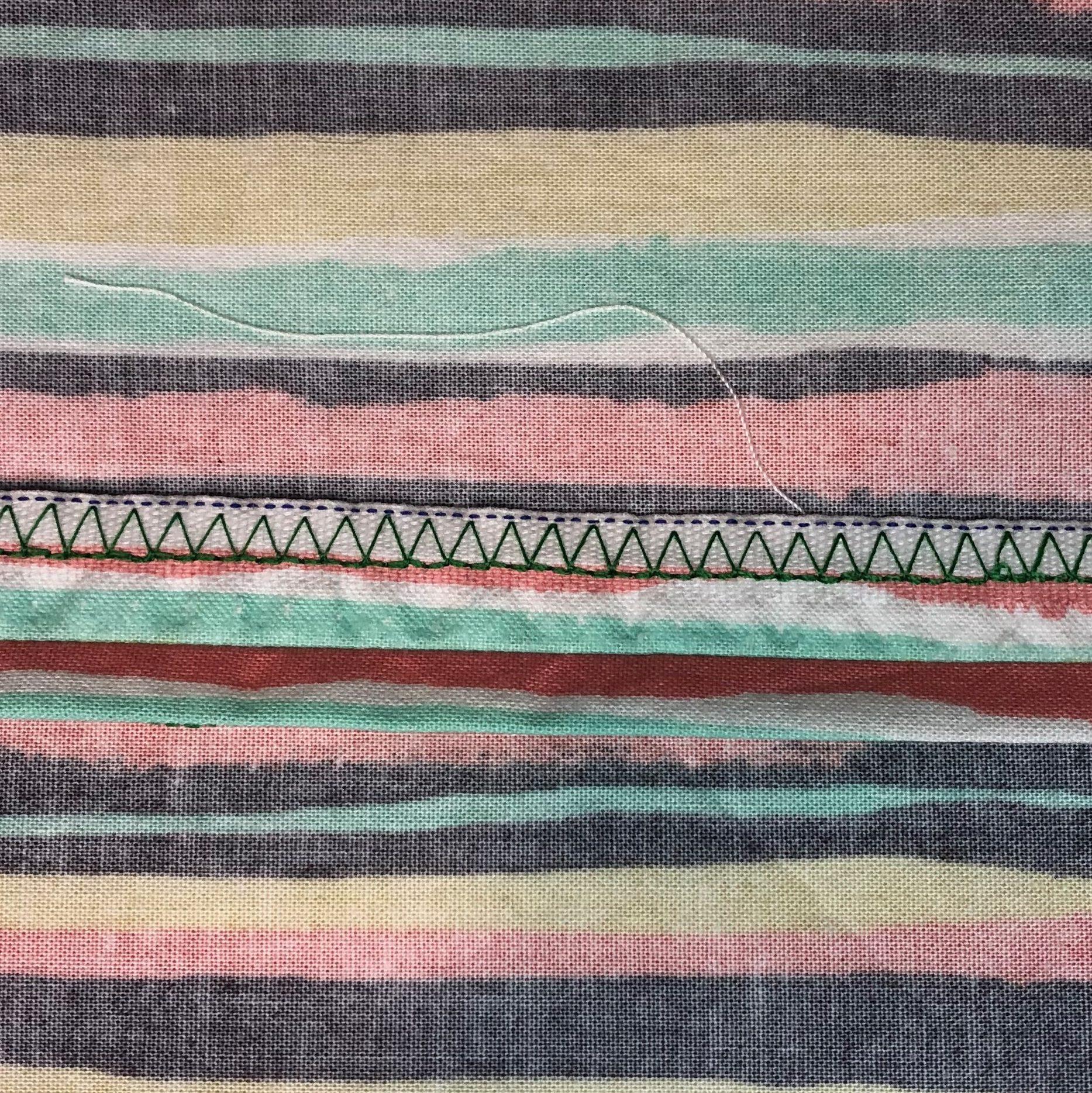 Over-edge stitched seam